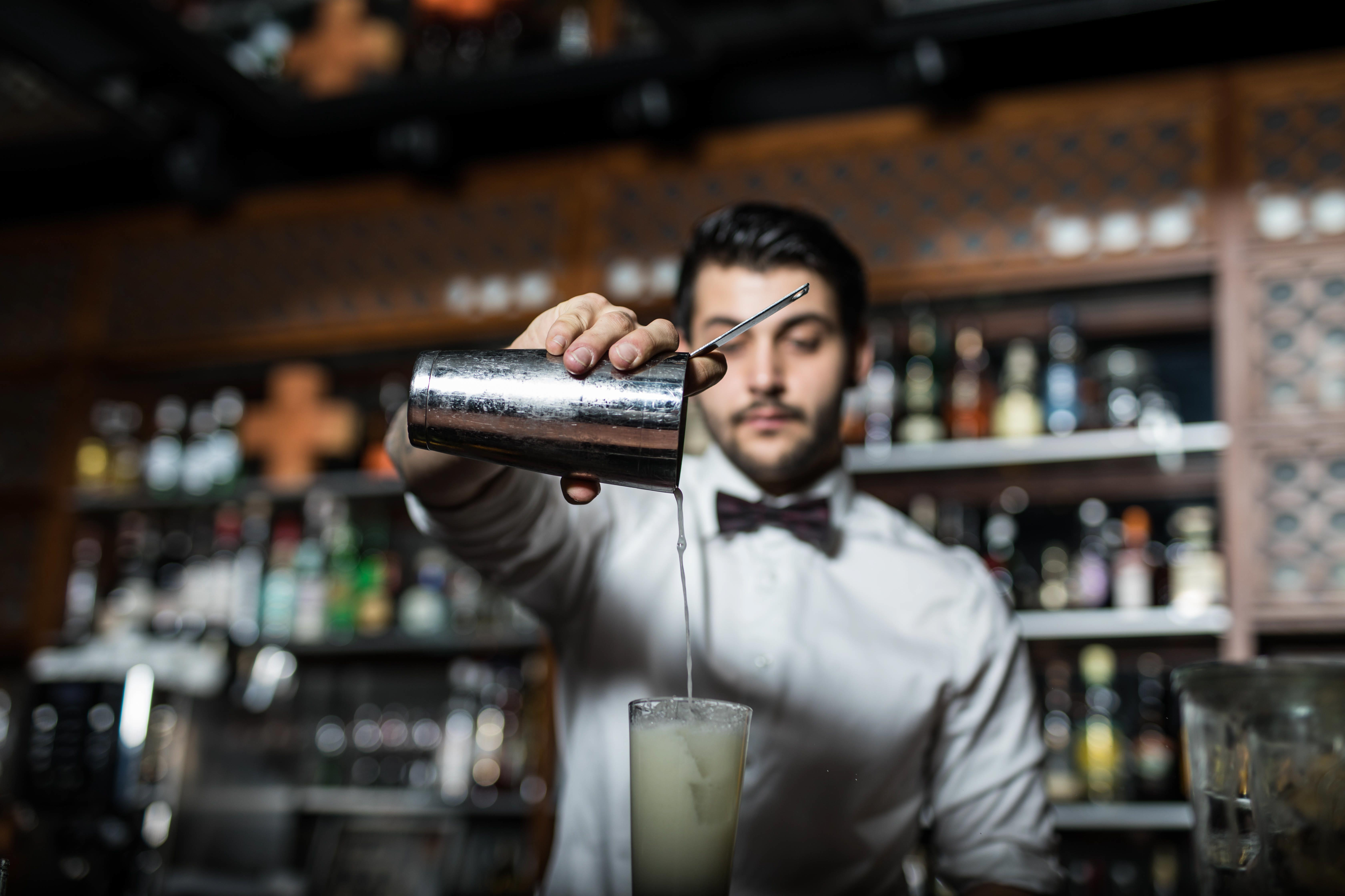 Barkeeper pouring a Cocktail