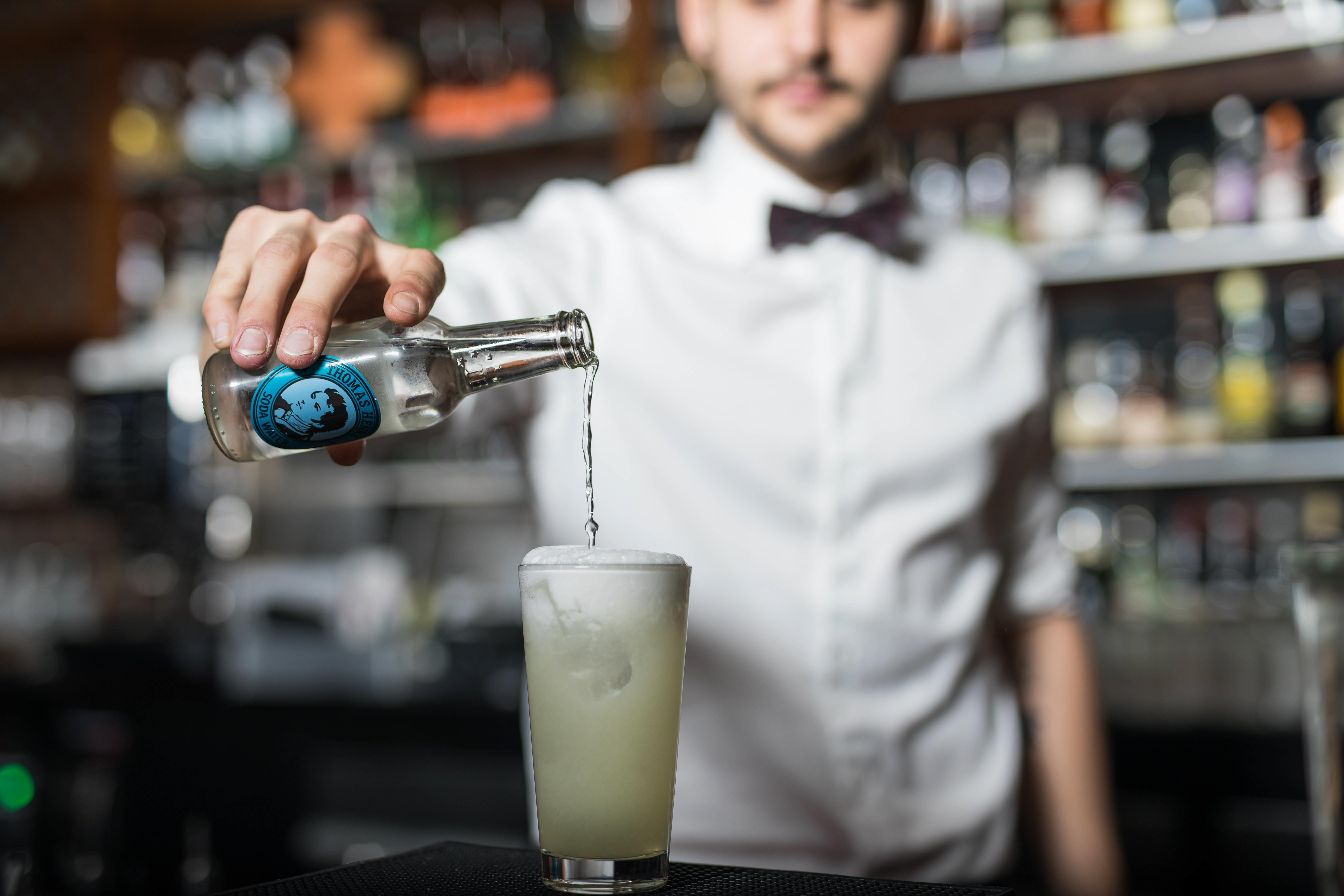 Barkeeper pouring Soda
